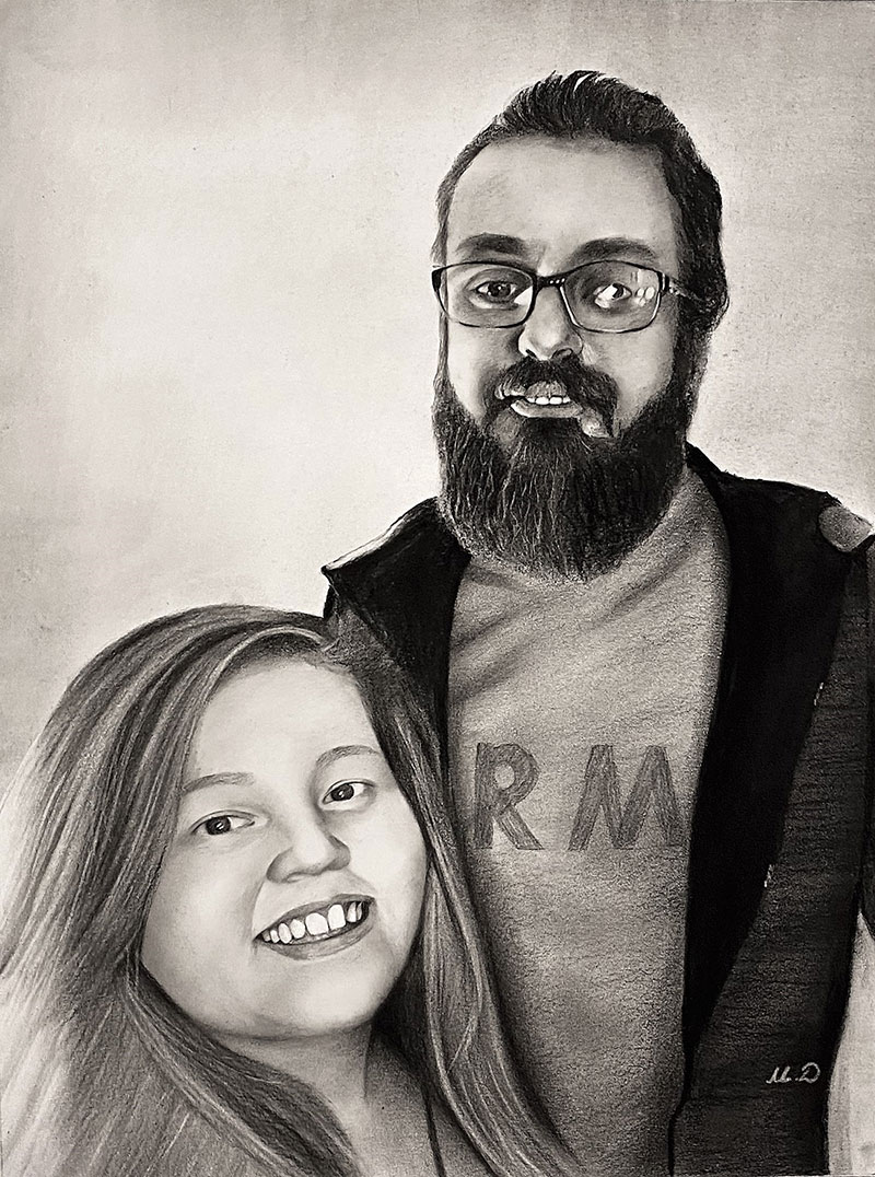 Personalized charcoal painting of a man and a girl