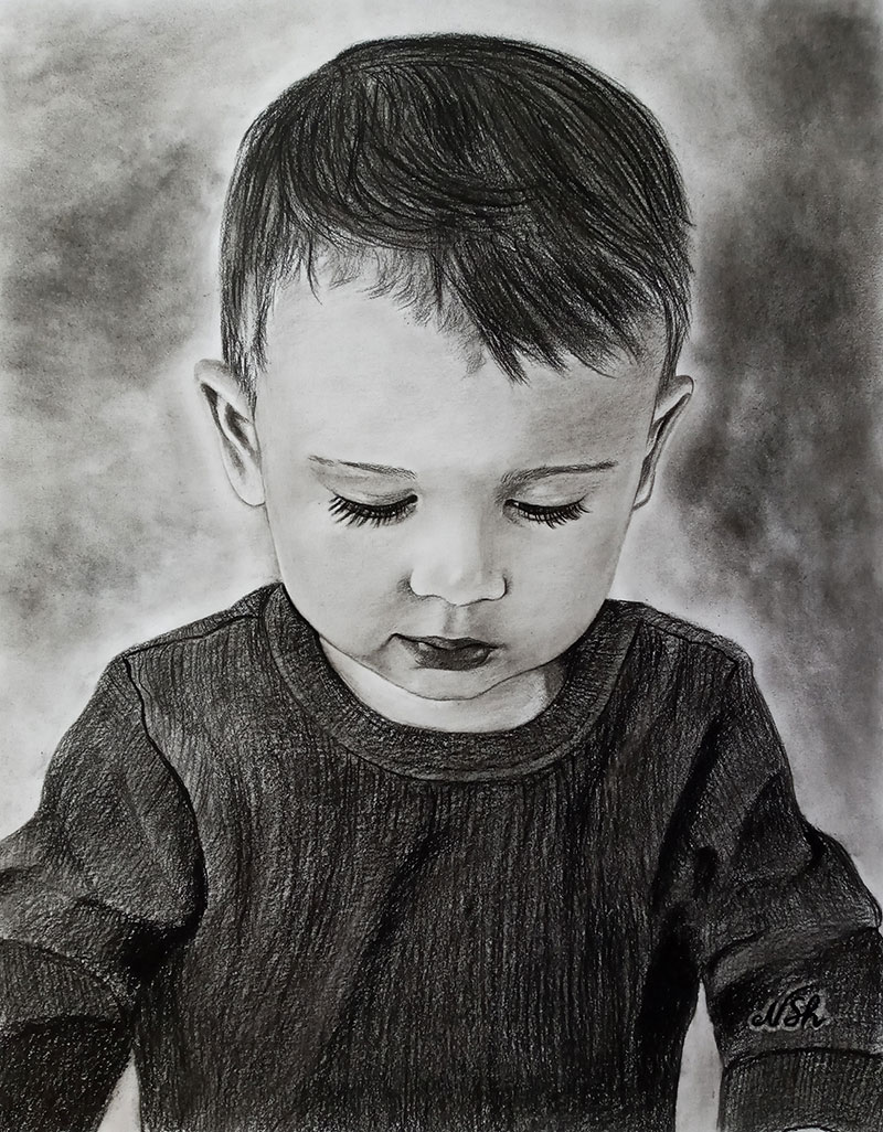 Beautiful handmade charcoal portrait of a boy