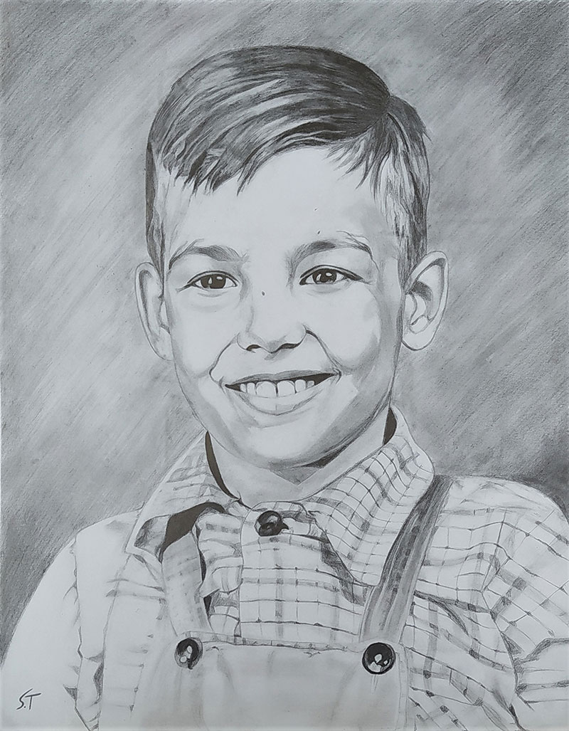 Beautiful black pencil portrait of a boy
