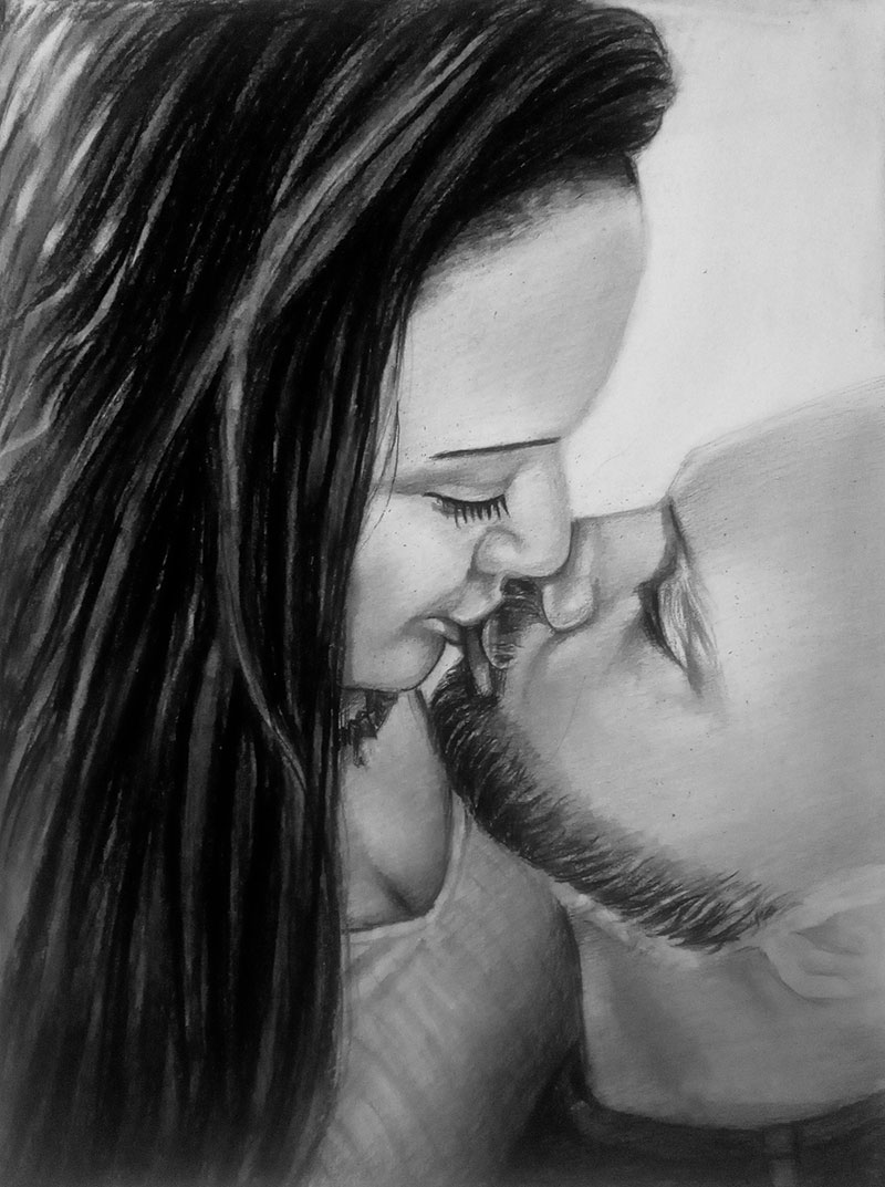 Beautiful charcoal drawing of a kissing couple