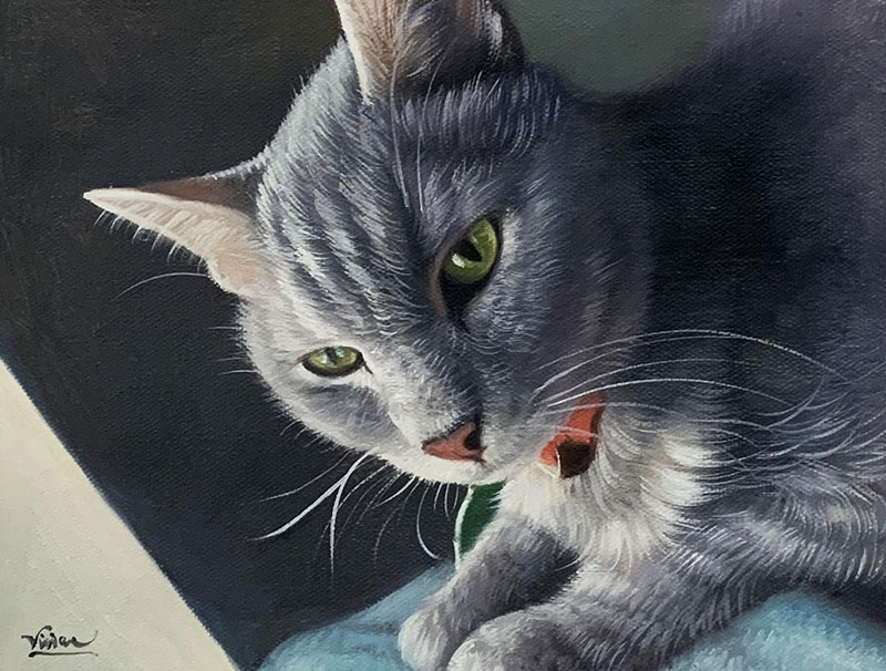 Beautiful acrylic painting of a cat with green eyes