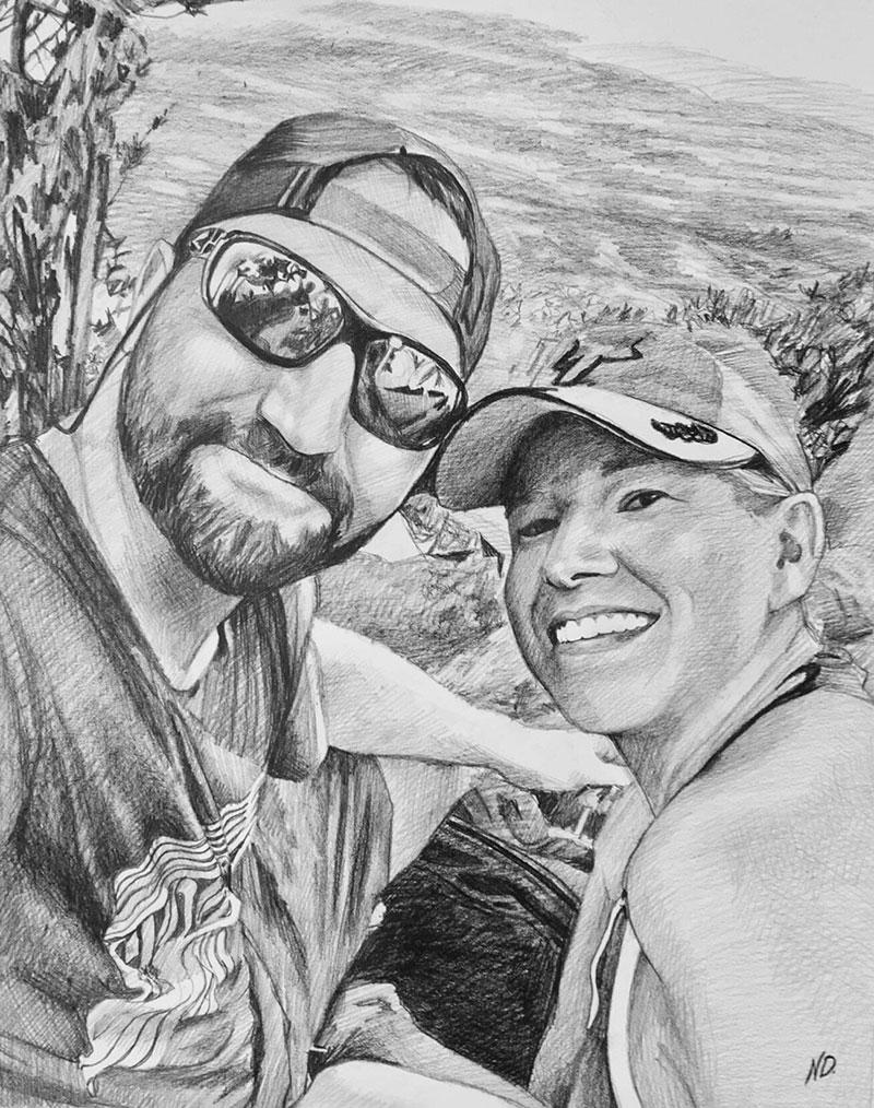 Custom handmade charcoal drawing of a happy couple