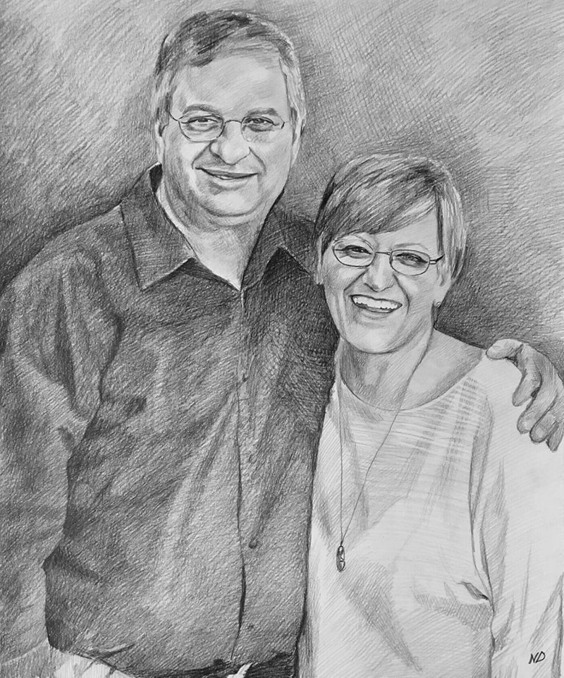 Custom black pencil drawing of a couple