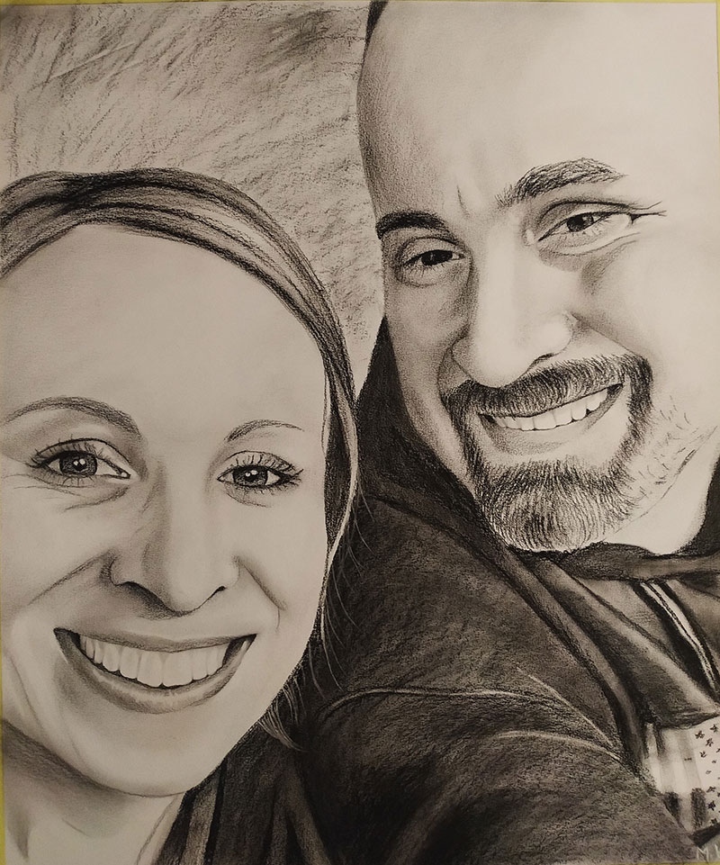 Gorgeous handmade black pencil drawing of a couple