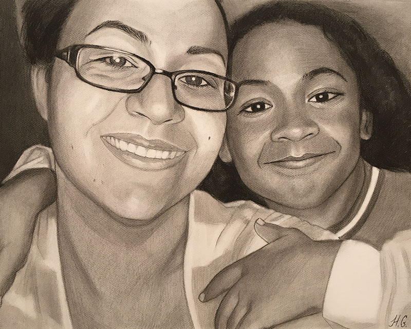 Beautiful close up charcoal drawing of a mother and daughter