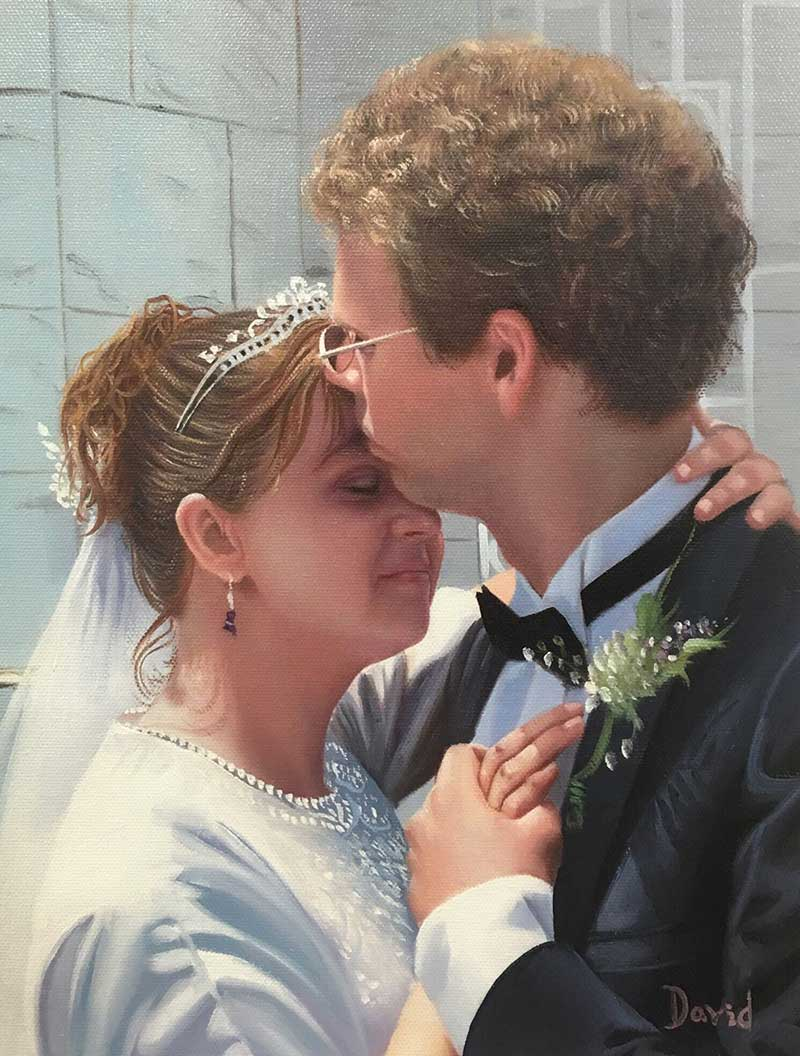 a custom wedding photo of a groom kissing bride on head