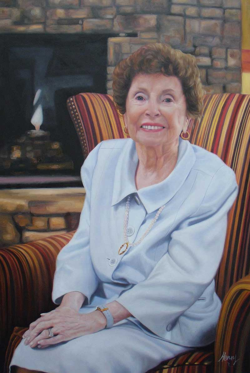 a custom oil painting of an eldery woman sitting by fire
