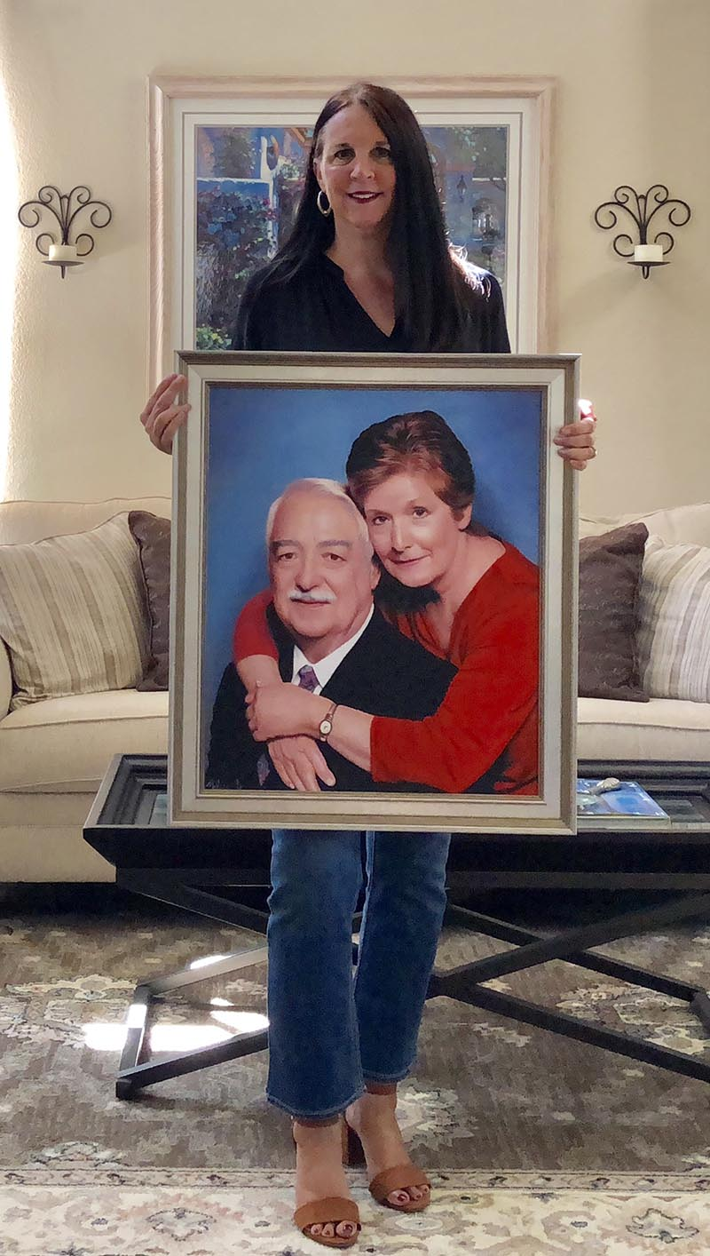 an oil painting of two loving elderly couple