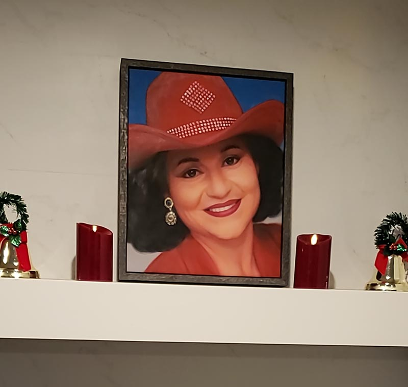 an oil painting of a female in a cowboy hat