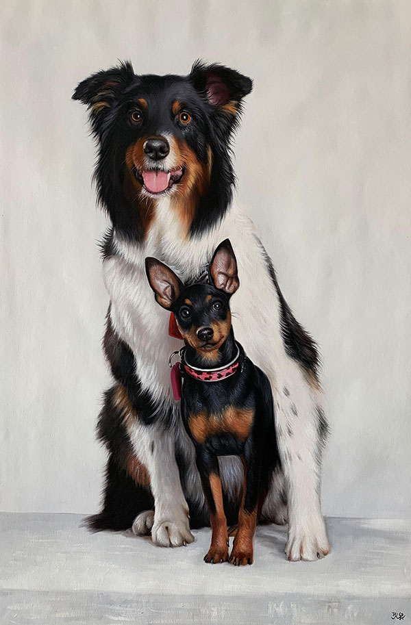 dogs portrait big dog hugging a small dog