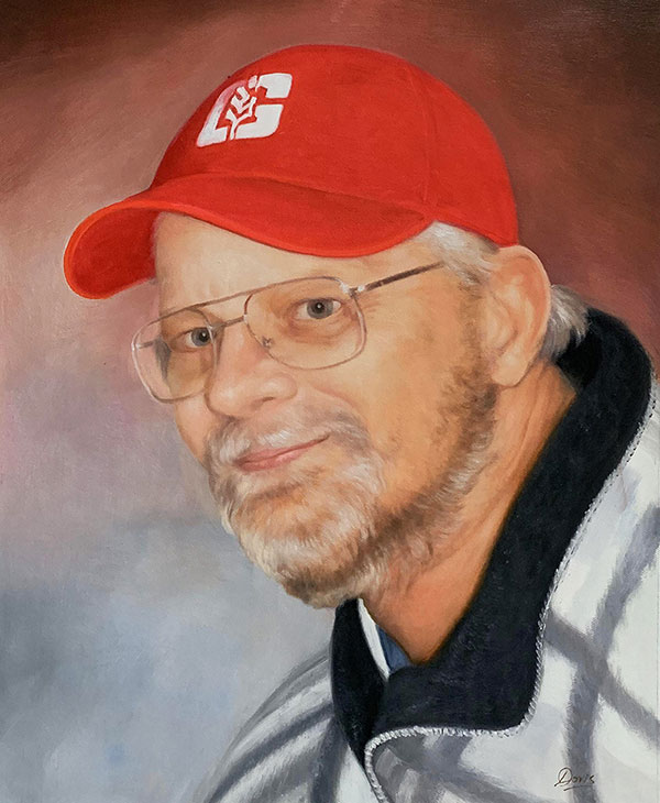 Close up oil portrait of a man with a red cap