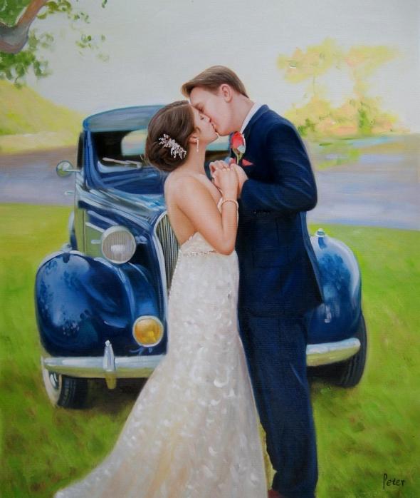 a wedding couple kissing by a blue car