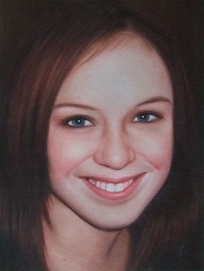 a custom oil portrait of a young woman with blue eyes