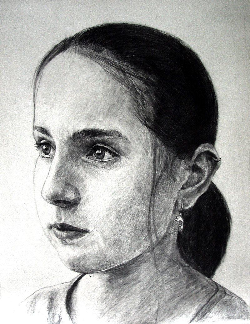 custom pencil drawing of a woman with her hair tied