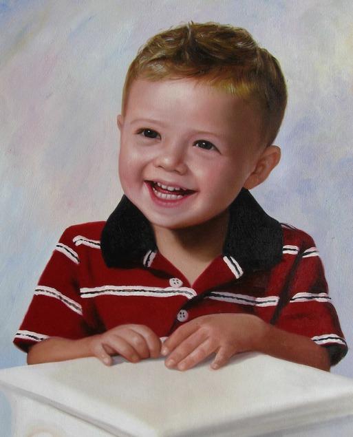 a custom oil portrait of a boy smiling