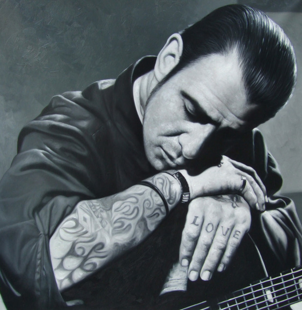 a black and white oil custom painting of a man with guitar