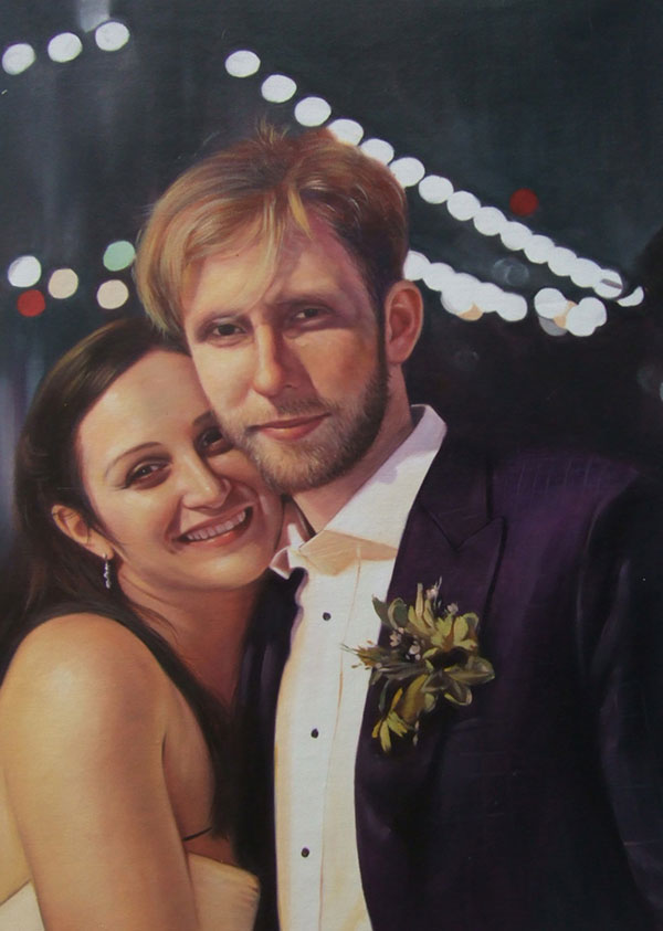 a custom oil painting of a wedding couple hugging at night